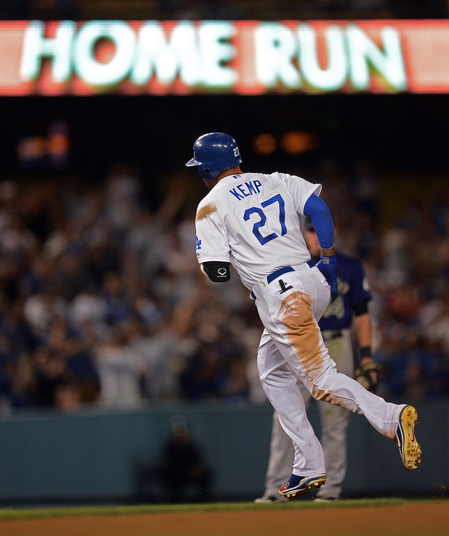 . Dodger Matt Kemp #27 rounds the bases after hitting a home run in the 4ht inning during their game against the Rockies at Dodger Stadium Saturday, September 29, 2012. (Hans Gutknecht/Staff Photographer)