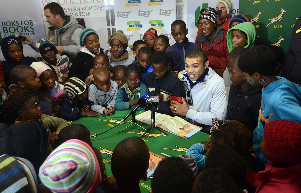 . Bryan Habana, wing for the Springbok and Stormers Rugby Teams, and former IRB Payer of the Year, reads a book about the life of Nelson Mandela, to local children, as part of the South African Rugby Union\'s and the City of Cape Town\'s contribution to Mandela Day, on July 18, 2014, in Langa, an impoverished area about 20Km from the centre of Cape Town. Mandela Day, celebrated on Nelson Mandela\'s birthday inspires people to give 67 minutes of their time, helping those less fortunate. 