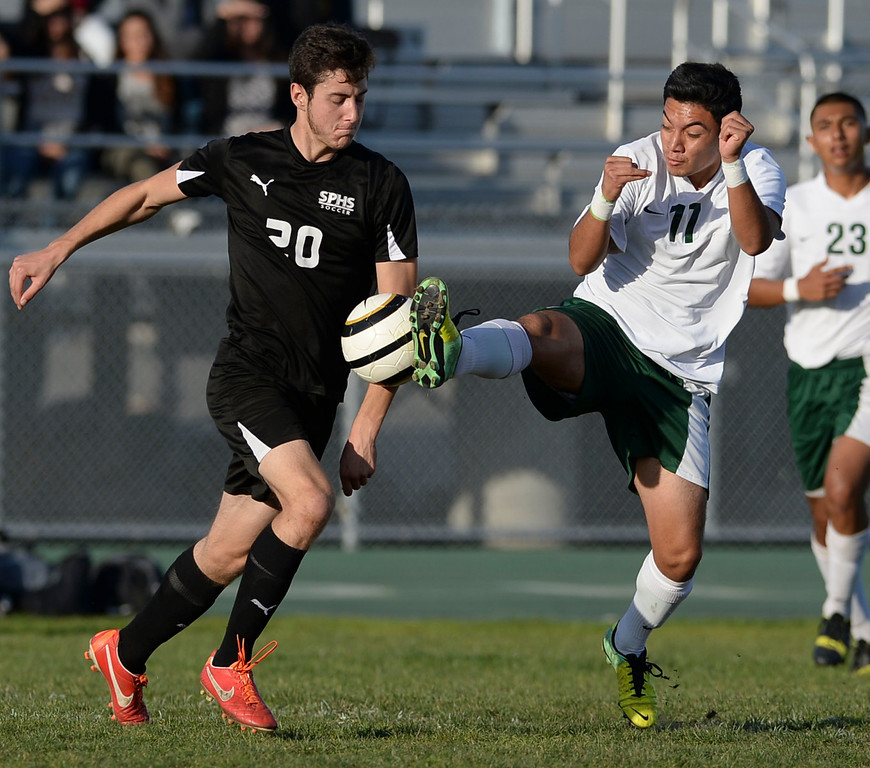 . Narbonne\'s Marco Cortez (17) takes the ball from San Pedro\'s Christian Sebastioni (20) in a Marine League boys soccer game Wednesday, February 12, 2014, Harbor City, CA.  Narbonne won 2-0 and seals the league title. Photo by Steve McCrank/Daily Breeze