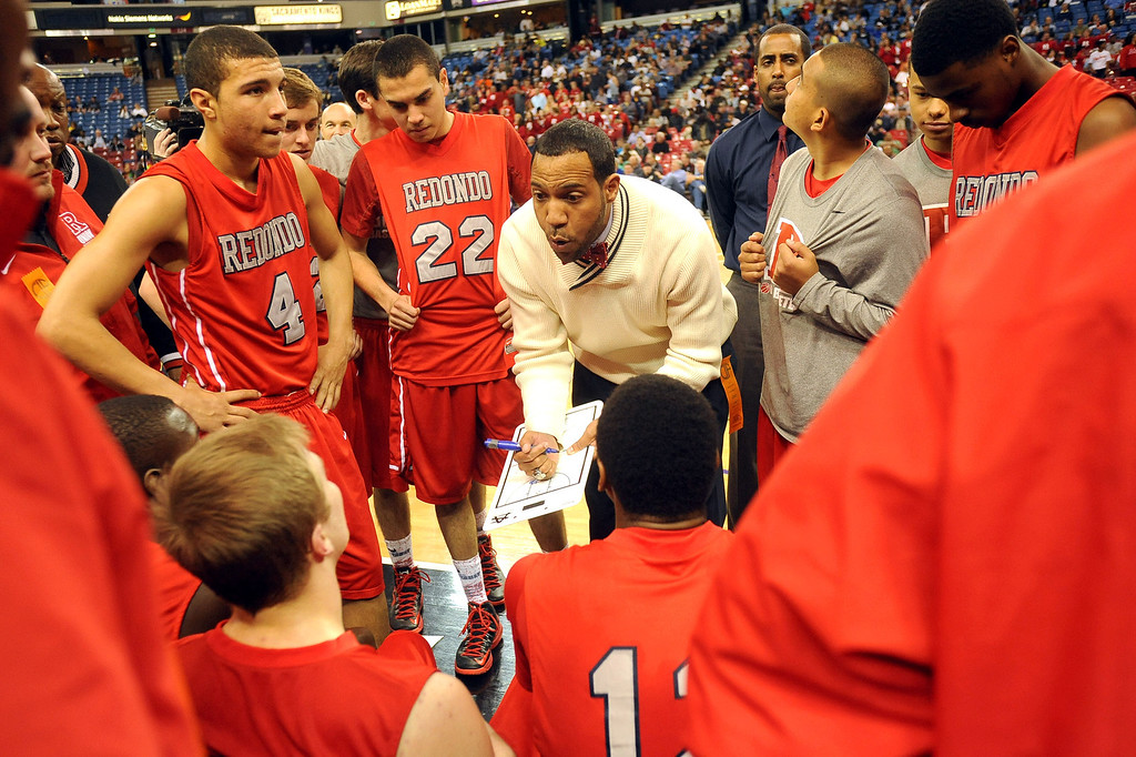 . Redondo Union head coach Reggie Morris Jr. draws up a play in the final minutes against College Park High School during the Division II 2013 CIF State Basketball Championships at Sleep Train Arena, in Sacramento, Ca March 23, 2013.  Redondo won the game 54-47.(Andy Holzman/Los Angeles Daily News)