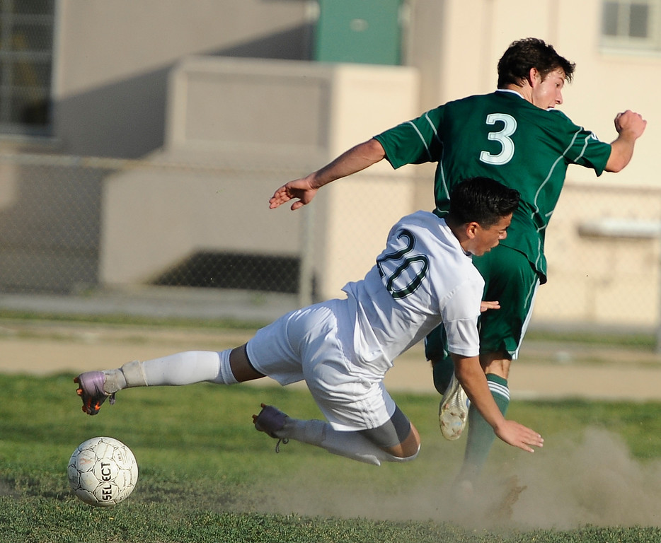 . March 4,2013. Canoga Park. Canoga Park #20 Omar Solarzano gets trip by Coronado #3 Drew Maracle, as Canoga took the win 2-0 during the first round of Southern California Div. II boys soccer regional playoffs   Photo by Gene Blevins/LA DailyNews