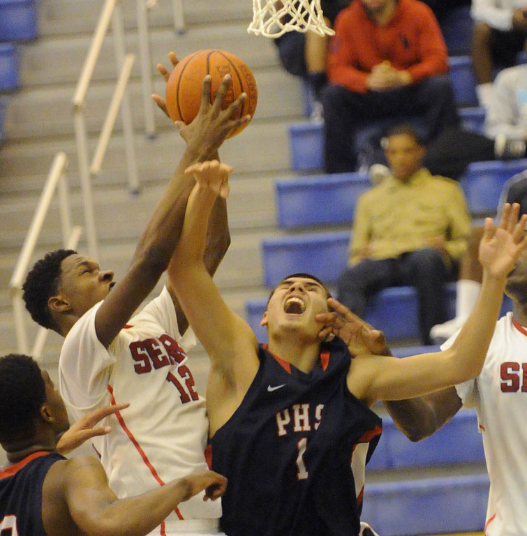 . 03-12-2013--(LANG Staff Photo by Sean Hiller)-Pacific Hills beat Serra 53-50 in Tuesday\'s boys basketball IV Southern California Regional semifinal at L.A. Southwest College. Serra\'s Tavrion Dawson battles for e rebound with Jonathon Mills.
