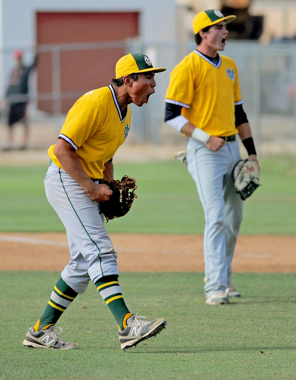 . 05-28-2013-( Sean Hiller/LANG) Mira Costa beat Elsinore 5-3 in Tuesday\'s CIF Southern Section Division III semifinal at Elsinore High School. Costa pitcher Gordon Cardenas celebrates after the final pitch.