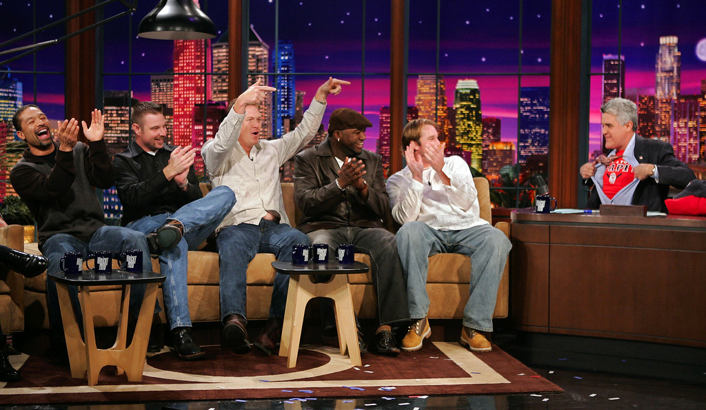 ". Members of the World Champion Boston Red Sox, from left, Dave Roberts, Alan Embree, Mike Timlin, David Ortiz and Derek Lowe reacts as Jay Leno rips open his shirt to reveal a ""Papie\"" t-shirt during their visit to the Tonight Show with Jay Leno, Monday night, Nov. 1, 2004, in Burbank, Calf. (AP Photo/Mark J. Terrill)"