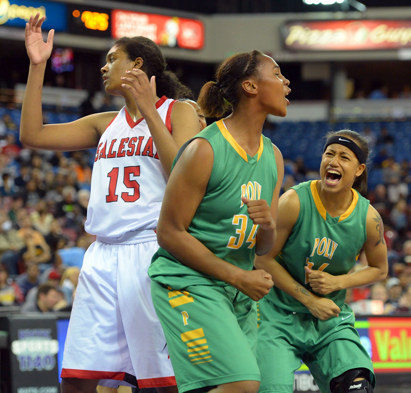 . Poly freshman Ayanna Clark, center, celebrates her basket and a foul at Sleep Train Arena in Sacramento, CA on Saturday, March 29, 2014. Long Beach Poly vs Salesian in the CIF Open Div girls basketball state final. 2nd half. Poly won 70-52. (Photo by Scott Varley, Daily Breeze)
