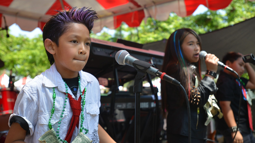 . 04-27-2013-(LANG Staff Photo by Sean Hiller)- The band Star Rat rocks out at the Cambodian New Year Celebration at El Dorado Park in Long Beach. The Cambodian community celebrated the year of the snake with Khmer traditional ceremonies, traditional and modern performances, live bands and famous Khmer singers performing throughout the day.