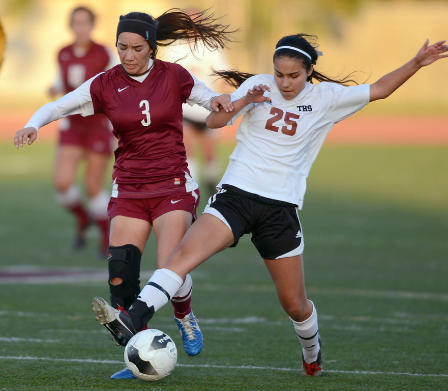 . Downey\'s Elizabeth Ham (3) and Torrance\'s Allison Arriola (25) battle each other for the ball in a CIF SS Division IV quarterfinal game Thursday at Zamperini Field. Downey won the game 3-1. 20130221 Photo by Steve McCrank / Staff Photographer