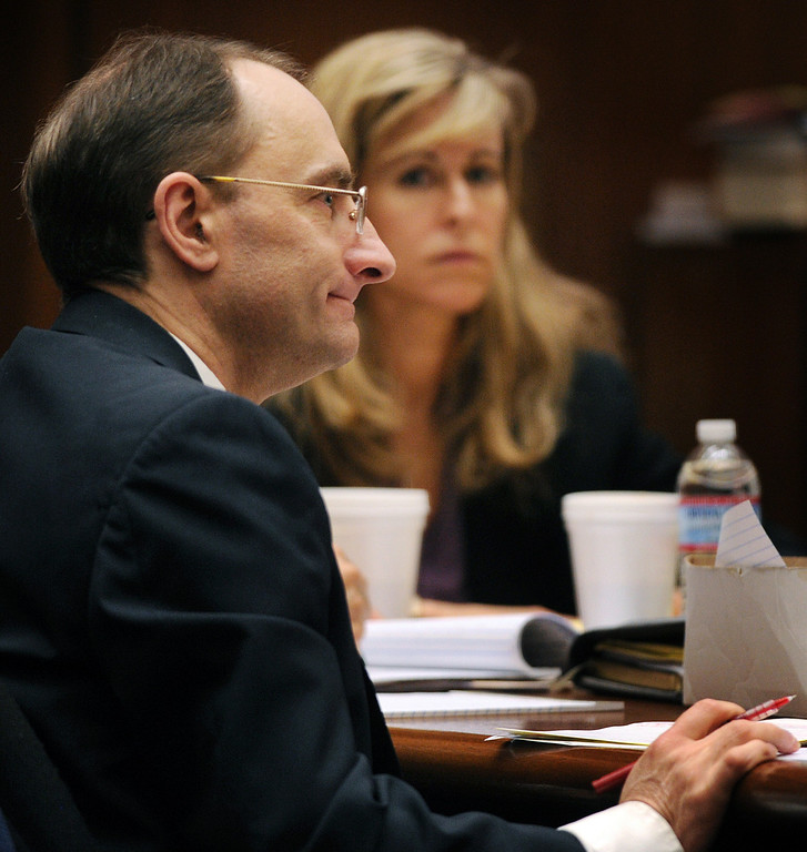 . Christian Karl Gerhartsreiter,  with one of his attorneys, Danielle Menard at Clara Shortridge Foltz Criminal Justice Center in Los Angeles Tuesday, March 26, 2013. He has pleaded not guilty to the killing of John Sohus, 27, who disappeared with his wife, Linda, in 1985 while Gerhartsreiter was a guest cottage tenant at the home of Sohus\' mother, where the couple lived. (Photo by Walter Mancini/SGVN)