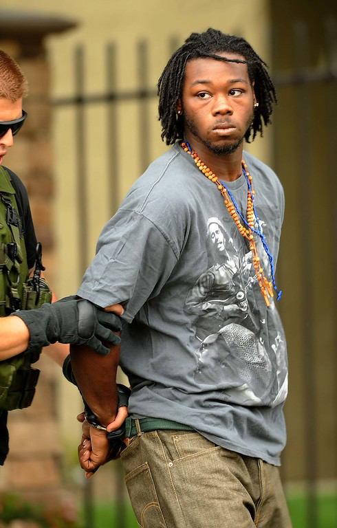 Description of . Robert Eugene Coleman, 21, of San Bernardino was taken into custody in connection with the shooting around 3 p.m. by sheriff's deputies after a search on land and by air, authorities said. He was booked into Central Detention Center in San Bernardino.(LaFonzo Carter/ Staff Photographer
