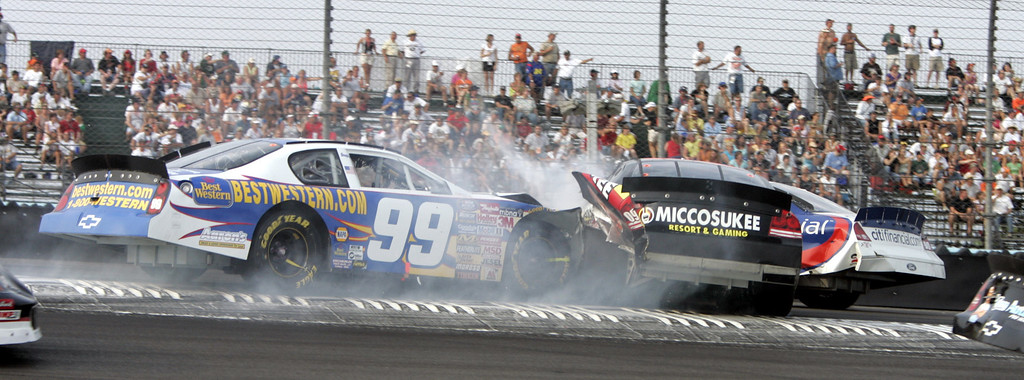 . Michael Waltrip (99) crashes into Boris Said, center, and Dale Jarrett in turn one during the NASCAR Zippo 200 Busch Series race at Watkins Glen International in Watkins Glen, N.Y., Saturday, Aug. 13, 2005. (AP Photo/David Duprey)