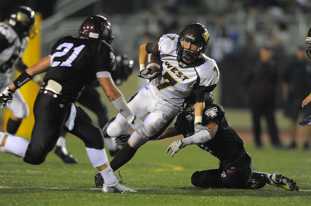 . West High takes on Torrance in a non league football game at Zamperini Stadium in Torrance, CA on Thursday, September 12, 2013. West\'s Kurtis Guelff is stopped after a 2nd qtr gain. (Photo by Scott Varley, Daily Breeze)