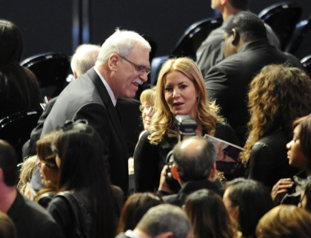 . Phil Jackson and Jeanie Buss talk to well wishers before the service. Family, friends current and former Lakers players and coaches attended a memorial service at the Nokia Theatre for Laker owner Jerry Buss who passed away on Monday, 2/18/2013 as a result of cancer. Los Angeles, CA 2/21/2013 John McCoy/Staff Photographer