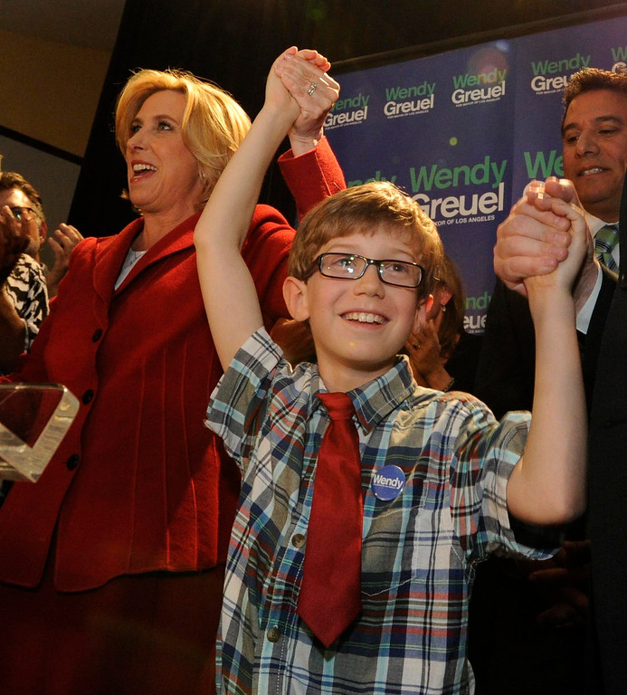 . Wendy Greuel holds her son Thomas Schramm,9, hand up in victory. Greuel held her election night party at the Los Angeles Brewing Company in downtown Los Angeles, CA 3/5/2013(John McCoy/Staff Photographer)