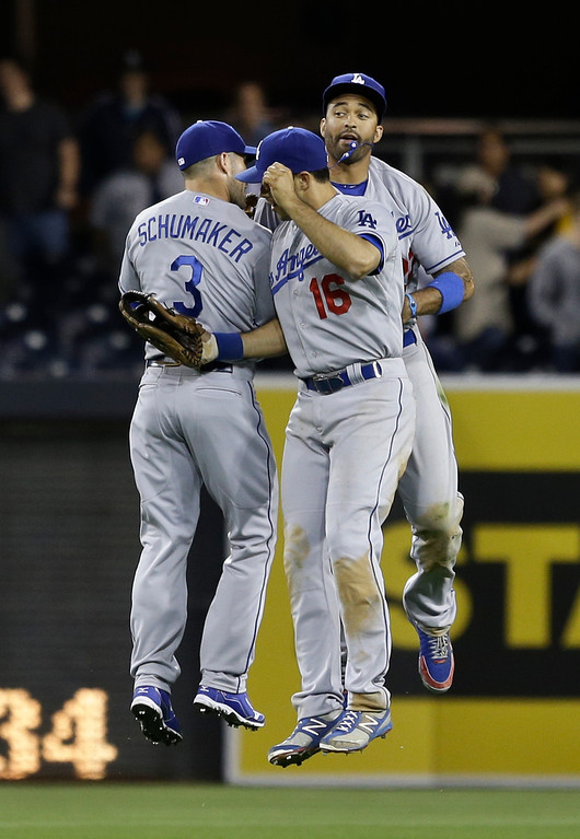 . Los Angeles Dodgers outfielders Skip Schumaker, Matt Kemp, and Andre Ethier celebrate the Dodgers 4-3 victory over the San Diego Padres in a baseball game in San Diego, Wednesday, April 10, 2013. (AP Photo/Lenny Ignelzi)