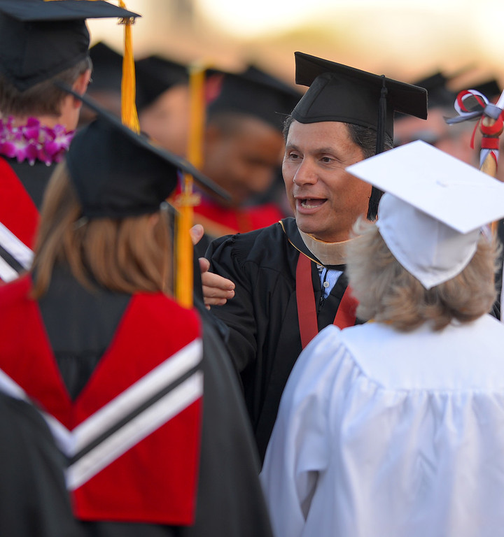 . Long Beach City College President Eloy Ortiz Oakley greets members of the class of 2014 as he enters Veterans Memorial Stadium in Long Beach, CA on Thursday, June 5, 2014. (Photo by Scott Varley, Daily Breeze)