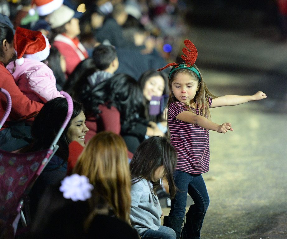 . The 60th annual Daisy Avenue Parade in the Wrigley neighborhood Saturday, December 13, 2013, in Long Beach, CA.   A young parade viewer dances with the music. Photo by Steve McCrank/DailyBreeze