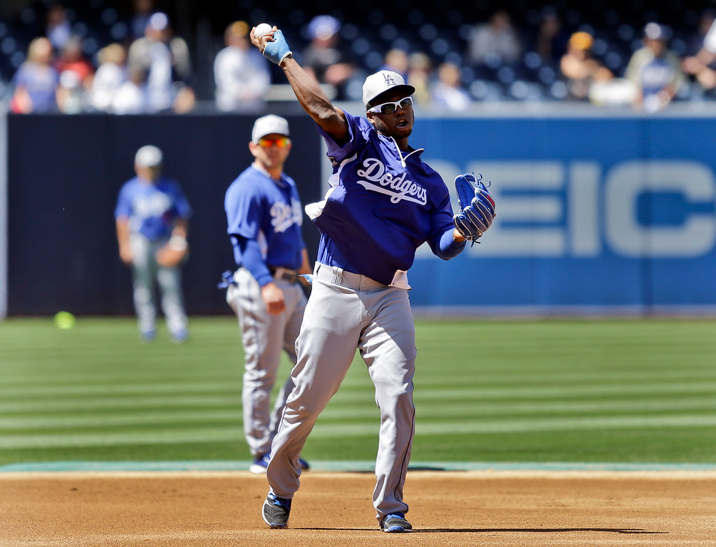 . Los Angeles Dodgers shortstop Hanley Ramirez, who is on the disabled list, throws during warm-ups before the San Diego Padres home opener against the  Dodgers in San Diego, Tuesday, April 9, 2013. (AP Photo/Lenny Ignelzi)