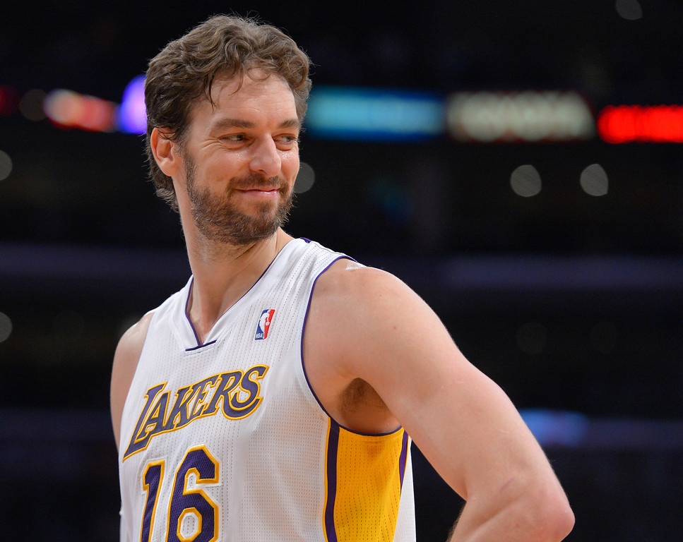 . Lakers\' Pao Gasol smiles a a young fan in the front row as he waits for a freethrow against the Denver Nuggets at the Staple Center in Los Angeles, CA on Sunday, January 5, 2014. 1st half.  (Photo by Scott Varley, Daily Breeze)