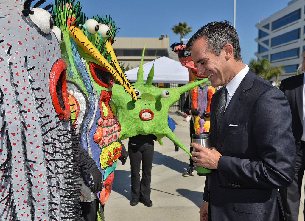 . 0917_NWS_TDB-L-HYPERION-- Los Angeles Mayor Eric Garcetti was on hand to open new Environmental Learning Center at Hyperion treatment plant in Playa Del Rey. Mayor Garcetti gets a laugh while talking to various water bacteria characters.   20130916 - Playa Del Rey, CA --  Photo by : Robert Casillas / DAILY BREEZE