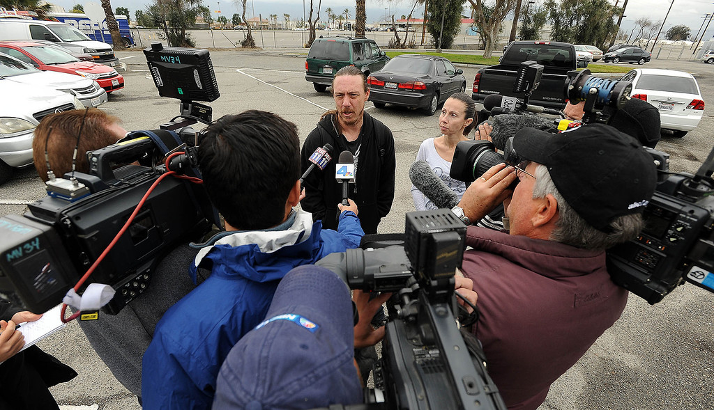 Description of . Dave Thomas, 36, of San Bernardino, speaks to media prior to being reunited with the dog at the City Animal Shelter in San Bernardino February 19, 2013. GABRIEL LUIS ACOSTA/STAFF PHOTOGRAPER.