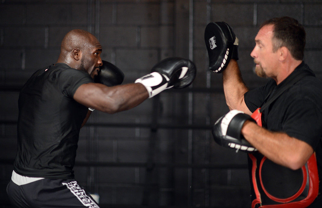 . Kevin Casey works with trainer Bo Hershberger at Black House in Gardena Monday, August 5, 2013. (Hans Gutknecht/Los Angeles Daily News)