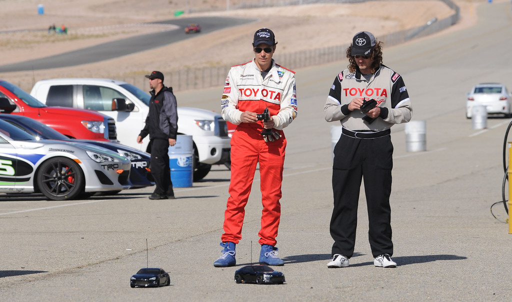 . Rosamond, Calif., -- 03-23-13-  Toyota Pro/ Celebrity Race participants actor Michael Trucco,left, and motocross champion Andy Bell,right,  race remote control cars during a practice session at Willow Springs Raceway. The Toyota Pro/Celebrity Race helps raise money on behalf of Racing for Kids, a fundraising program benefiting Miller Children�s Hospital in Long Beach and Children�s Hospital of Orange County. On behalf of the race and its participants, Toyota has donated more than $2 million to various children�s hospitals since 1991.  Stephen Carr/  Los Angeles Newspaper Group