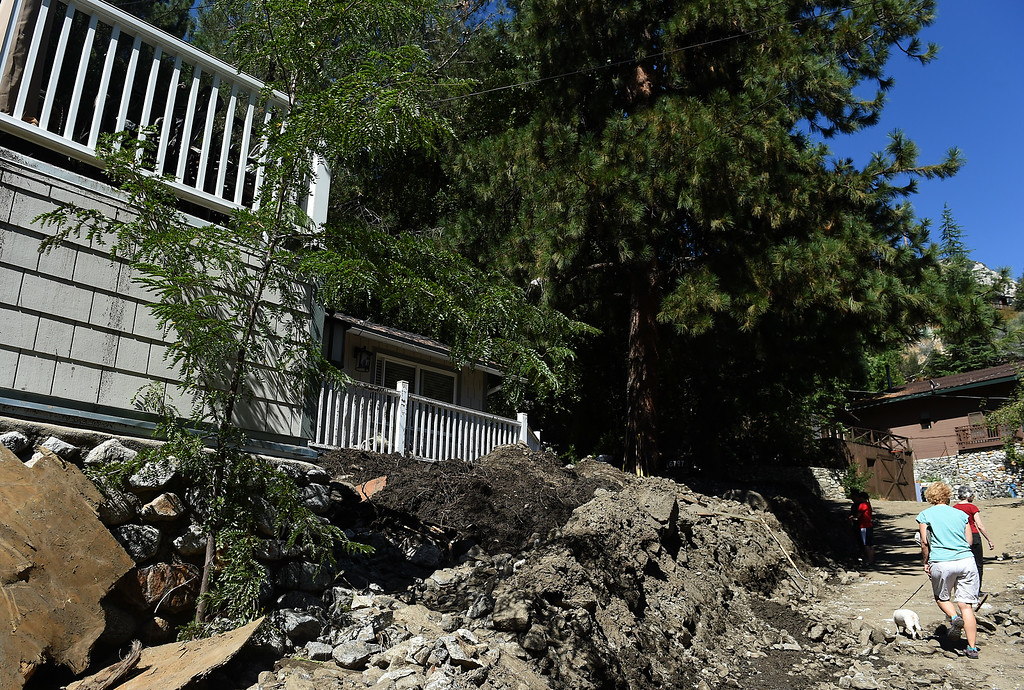Description of . Clean-up from Sunday's storm continues in Mt. Baldy, CA, Tuesday, August 5, 2014. (Photo by Jennifer Cappuccio Maher/Inland Valley Daily Bulletin)