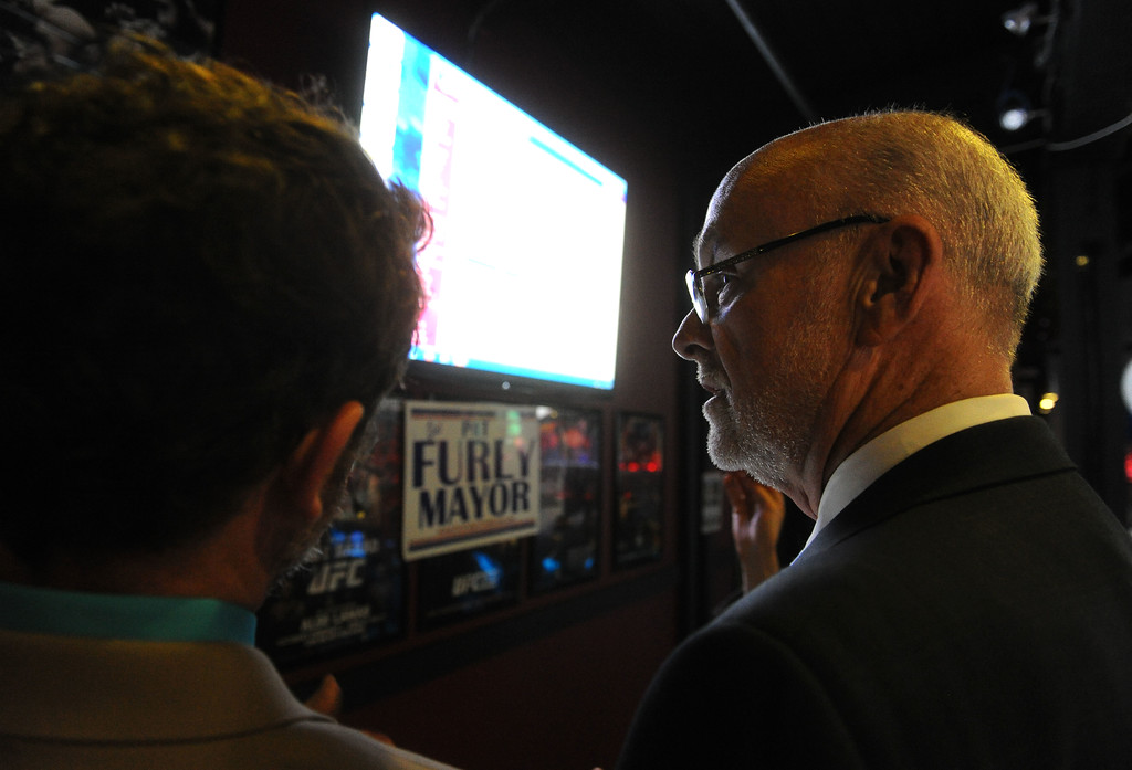 . Torrance mayoral candidate Pat Furey, right, and his son, Patrick look over early result numbers at his election night party at Industry Bar in Torrance, CA on Tuesday, June 3, 2014. (Photo by Scott Varley, Daily Breeze)