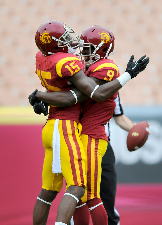 . WR Nelson Agholor, left, celebrates with Marqise Lee after hauling in a 44-yard touchdown pass from Max Browne during USC\'s Spring Football Game. (Michael Owen Baker/Staff Photographer)