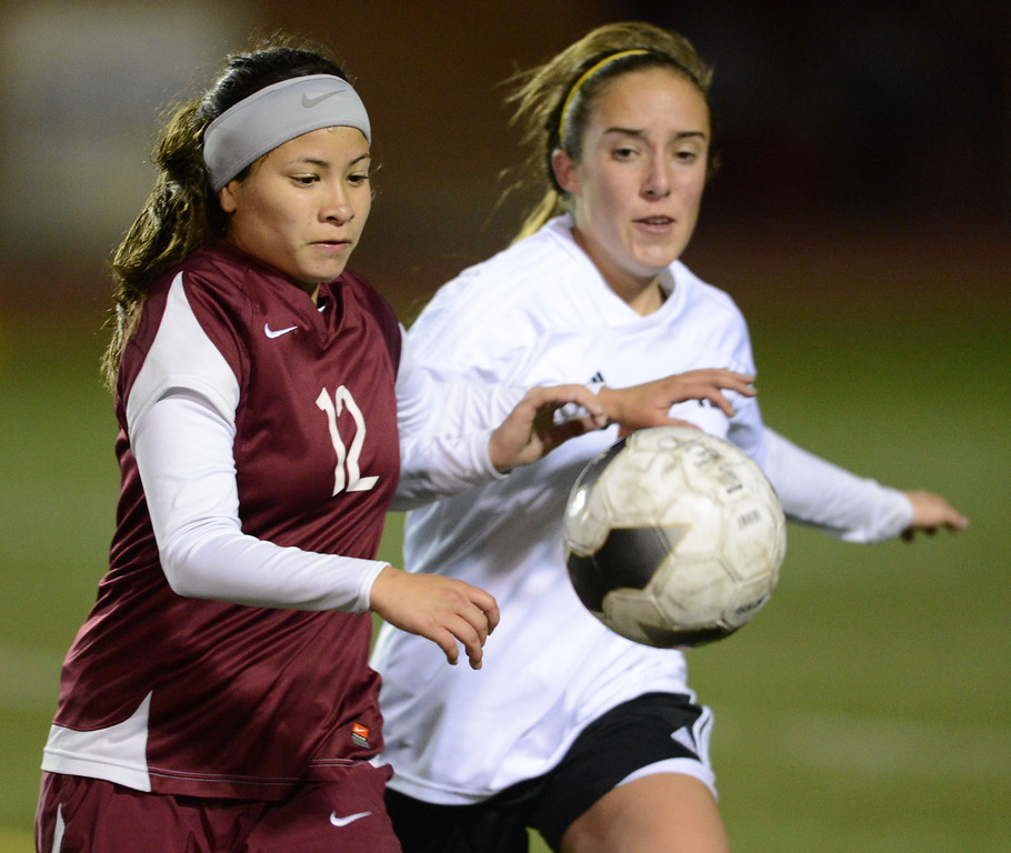 . Downey\'s Lucy Martinez (12) gets to the ball ahead of Torrance\'s Brianna Brown (31) in a CIF SS Division IV quarterfinal game Thursday at Zamperini Field. Downey won the game 3-1. 20130221 Photo by Steve McCrank / Staff Photographer