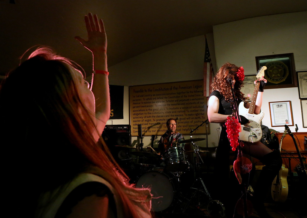 . Fans cheer on Erica Valentine, on the electric guitar, at tryouts for the Doo Dah Queen. The event, which was held at the American Legion Bar in Pasadena on Sunday, April 7, 2013. was attended by hopeful contestants, judges, and fans of the parade.  ( Photo by Nancy Newman / Pasadena Star-News Correspondent )