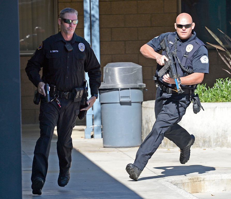. The Hermosa Beach and Manhattan Beach Police Depts. conducted an active shooter drill on the campus of Hermosa Valley School Monday, November 25, 2013, Hermosa Beach, CA.   Officers responded to staged calls of a gun man on the campus, had to find and neutralize the suspect. Officers stream onto campus looking for the shooter. Photo by Steve McCrank/DailyBreeze