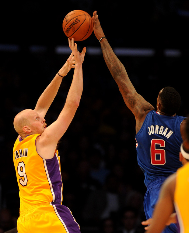 . Lakers#9 Chris Kaman is blocked by Clippers#6 DeAndre Jordan in the first half. The Los Angeles Lakers played the Los Angeles Clippers in the opening game of the season at Staples Center. Los Angeles, CA. 10/29/2013. photo by (John McCoy/Los Angeles Daily News)