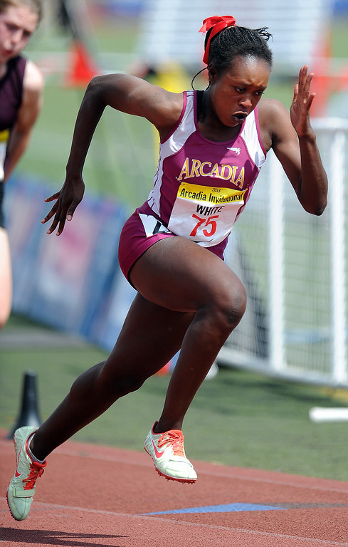 Description of . Arcadia's Kyra White competes in the 200 meters race in the during the Arcadia Invitational at Arcadia High School on Saturday, April 6, 2013 in Arcadia, Calif.  (Keith Birmingham Pasadena Star-News)