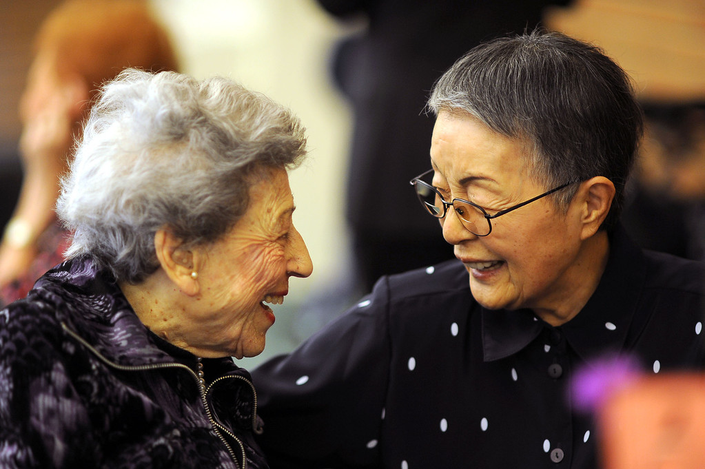 . Myrtle Feenberg and Akiko Collins share a smile while sitting down for a traditional Passover Seder at the Los Angeles Jewish Home in Reseda, CA March 20, 2013.  More than a dozen residents of Keiro Senior Healthcare in Boyle Heights joined residents of the Los Angeles Jewish Home for the religious celebration Wednesday.(Andy Holzman/Los Angeles Daily News)