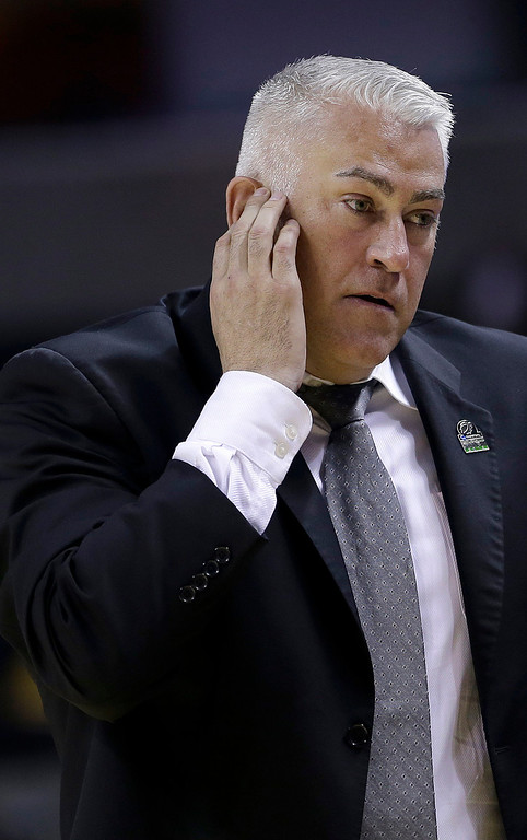 . Montana head coach Wayne Tinkle reacts during the second half of a second-round game in the NCAA college basketball tournament against Syracuse in San Jose, Calif., Thursday, March 21, 2013. Syracuse won 81-34. (AP Photo/Ben Margot)