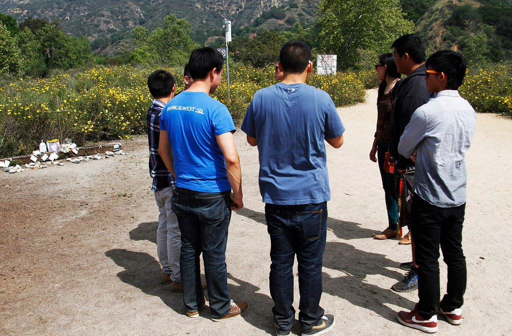 . Friends gather at a memorial for Esther Suen, at the start of the hiking trail, at Eaton Canyon Park in Altadena, Monday, March 25, 2013. Esther Suen a 17-year old Mark Keppel High School student fell 200 feet and was killed on a hiking accident on Friday at Eatyon Canyon Park. (Correspondent Photo by James Carbone/SXCITY)