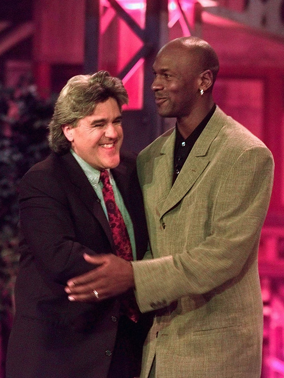 ". Chicago Bulls\' Michael Jordan hugs Jay Leno Friday, May 3, 1996, in Rosemont, Ill., after being introduced during a taping of ""The Tonight Show.\""   (AP Photo/Michael S. Green)"