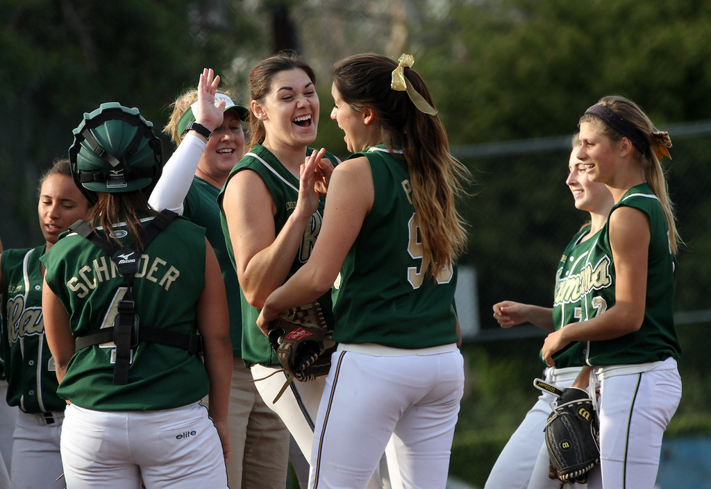 . Temple City High School celebrates winning a softball game against San Marino High School at San Marino High School in San Marino, March 19, 2013. (Correspondent photo by Larry Goren/Sports)