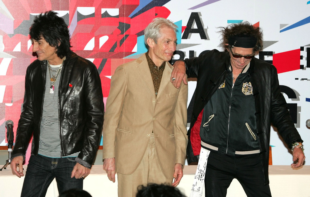 ". Rolling Stones members, from left., Ron Wood, Charlie Watts and Keith Richards arrive for a press conference in Shanghai, China, Friday April 7, 2006. The Rolling Stones are to play a concert in Shanghai Saturday as part of their ""A Bigger Bang\"" world tour. The performance is their first in mainland China after a previously scheduled concert was cancelled in 2003 due to the SARS crisis. (AP Photo/Greg Baker)"