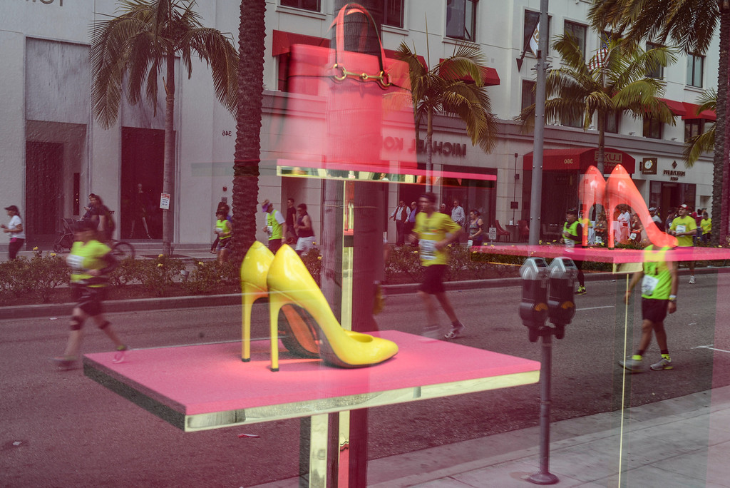 . Expensive shoes and runners come together on Rodeo Drive in Beverly Hills during the 28th Los Angeles Marathon.  Photo by David Crane/Staff Photographer