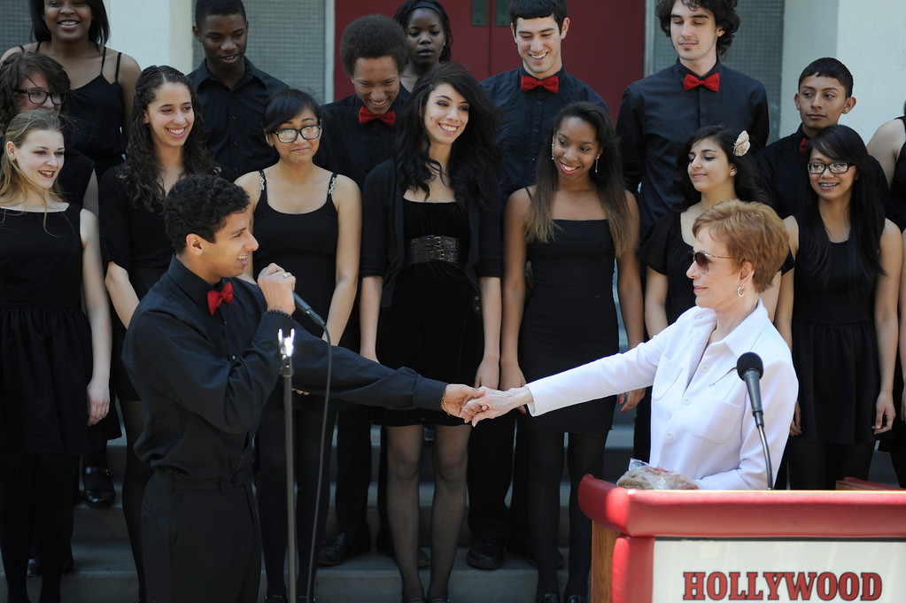 ". Students from H2O sing to Carol Burnett, award-winning actress, comedienne and best-selling author, was honored by the City of Los Angeles for her lifetime achievements with the naming of Carol Burnett Square at the intersection of Highland Avenue and Selma Avenue. The Square is adjacent to Hollywood High School where Burnett attended. Students from the school choir, ""H2O\"" sang �I�m so glad we had this time together,� before Burnett and LA City Councilman Tom LaBonge unveiled her street sign. Hollywood, CA 4/18/2013(John McCoy/Staff Photographer"