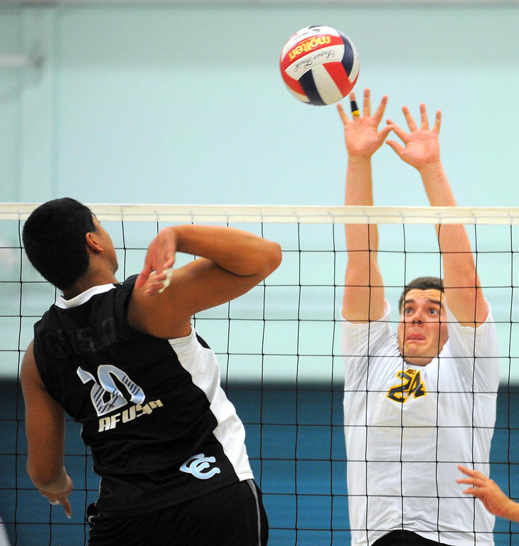 . CARSON - 04/09/2013  (Photo: Scott Varley, Los Angeles Newspaper Group)  San Pedro vs Carson boys volleyball. Carson won 3-0. San Pedro\'s J.J. Peacock readies himself to block Wellington Afusia\'s spike.