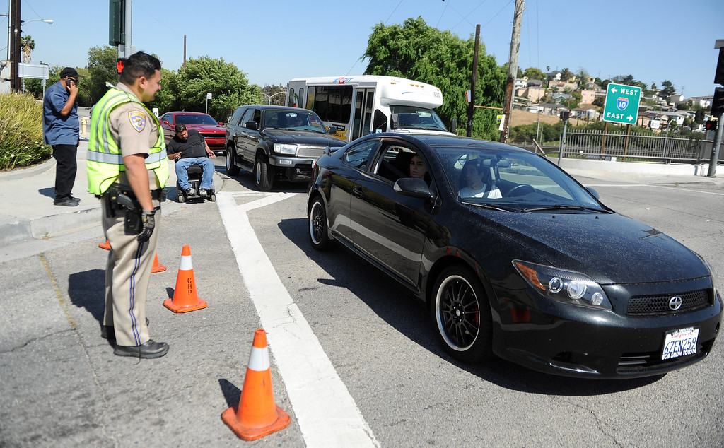 . California Highway Patrol officers keeps cars away as the campus of Cal State Los Angeles was closed due to a bomb threat on Thursday, April 18, 2012 in Los Angeles, Calif.    (Keith Birmingham/Pasadena Star-News)