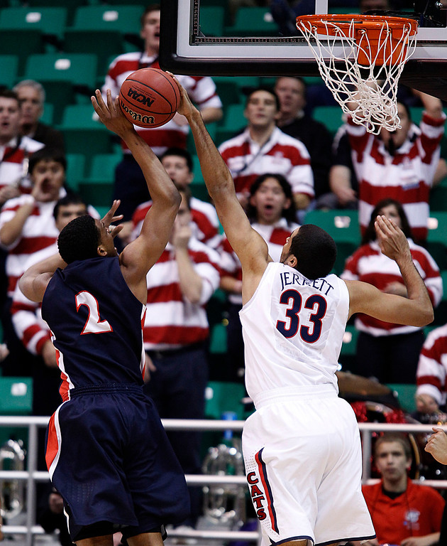 . Belmont\'s Blake Jenkins (2)  has his shot blocked by Arizona\'s Grant Jerrett during the first half of a second-round game in the NCAA college basketball tournament in Salt Lake City Thursday, March 21, 2013. (AP Photo/George Frey)