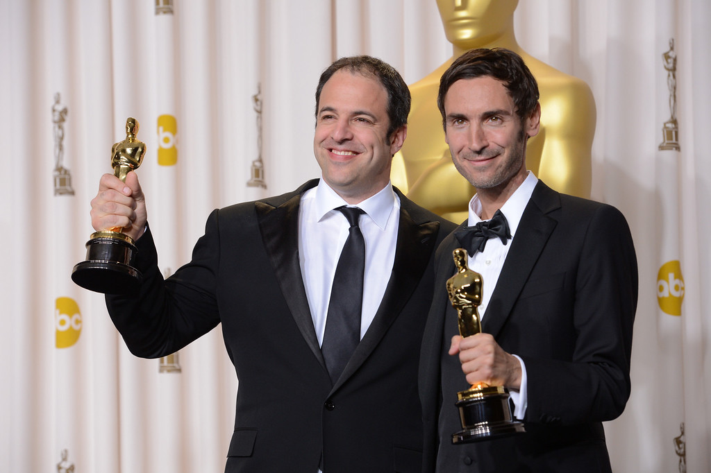 """. Malik Bendjelloul and Simon Chinn accept the award for best documentary feature for \""""Searching for Sugar Man\"""" backstage at the 85th Academy Awards at the Dolby Theatre in Los Angeles, California on Sunday Feb. 24, 2013 ( David Crane, staff photographer)"""