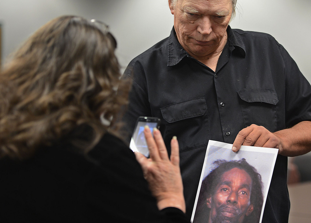 Description of . Phillip Kelley holds a photo of murder suspect of Jerome Anthony Rogers, 55, of San Bernardino, as his wife Nancy Kelley takes a photo. Kelley is the son of murder victim Josephine Kelley. Rogers was arrested Friday and booked into West Valley Detention Center in Rancho Cucamonga in the killing of Mary Beth Blaskey. The Kelley's say they're hopefully with Friday's arrest that their mother's killer will be found. Rick Sforza/Staff photographer