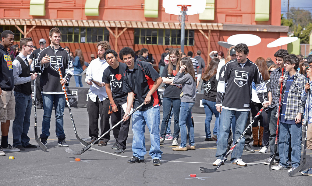 . Raytheon Space and Airborne systems engineers teamed up with LA Kings players Justin Williams, #14, and Willie Mitchell #33 at DaVinci High School in Hawthorne to learn about geometry and how it plays into the game of hockey.   Photo by Brad Graverson 3-8-13