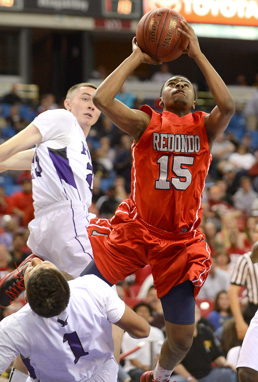 . Cameron High of Redondo Union High School puts up a shot against College Park High School during the Division II 2013 CIF State Basketball Championships at Sleep Train Arena, in Sacramento, Ca March 23, 2013.  Redondo won the game 54-47.(Andy Holzman/Los Angeles Daily News)