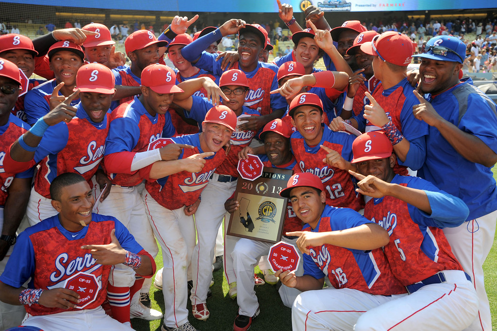 . Serra celebrates and poses for photos with their awards after beating Mira Costa in the CIF-SS Division III championship baseball game Friday at Dodger Stadium. Serra won the title, 8-1. 20130531 Photo by Steve McCrank / Staff Photographer